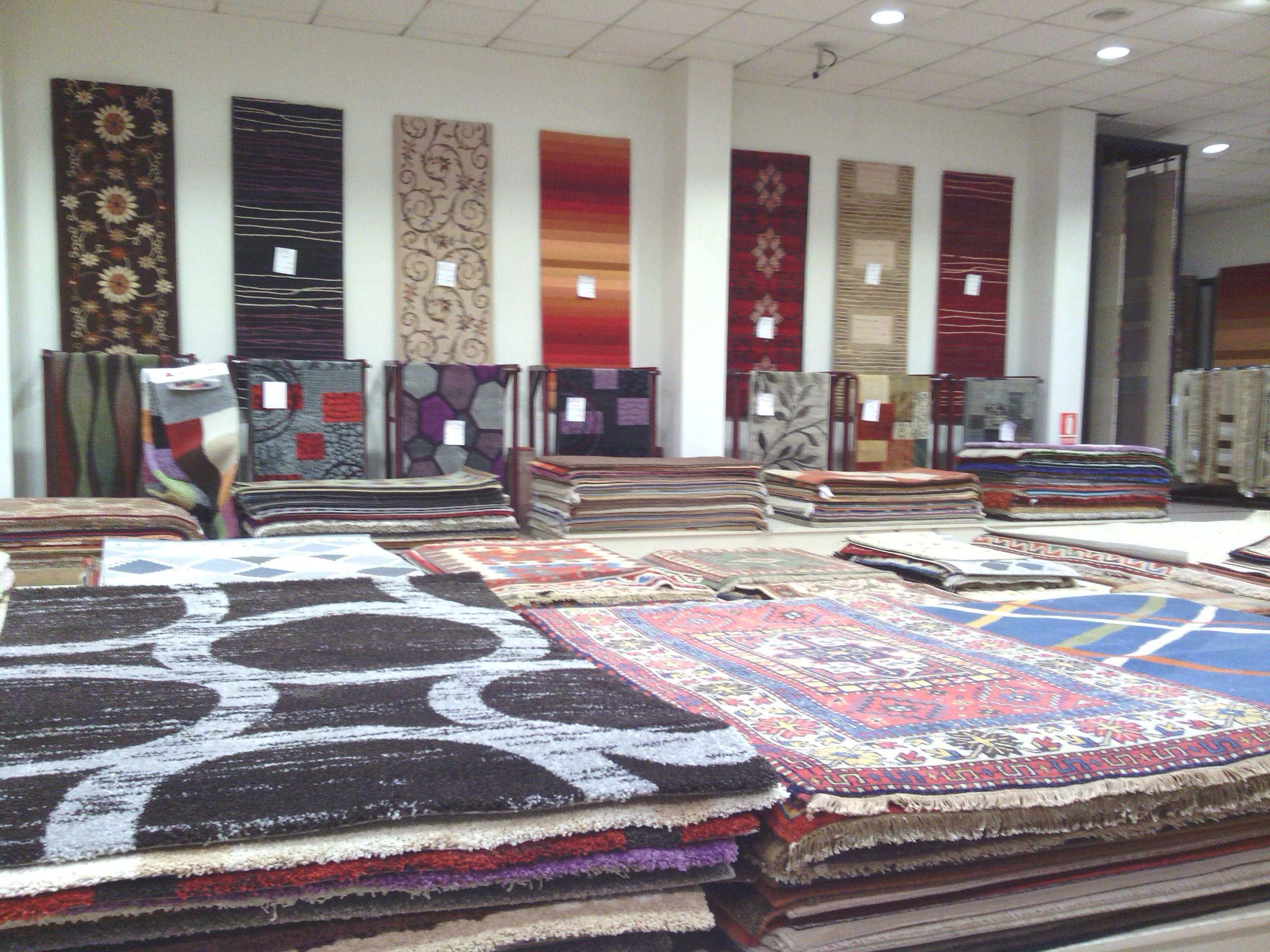 Nuestras tiendas tejidos el mundo for Alfombras el mundo